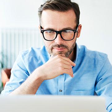 Man viewing laptop screen